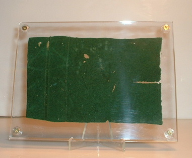 This dark green felt-like baize fabric measures 4 1/2  x 7  and is just a small representation of a very large piece in the collection. & Authentic felt from the Titanic - museum piece